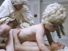 Staggering costumed girls with hairy twats are getting dicks in all of their holes in this great vintage porn video.
