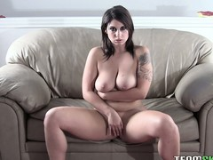 Lying on the couch, the hot babe masturbates plus reveals say no to remarkable tits plus ass