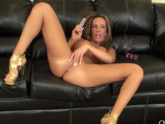 Richelle Ryan lays back to fuck herself in a pair of presumptuous heels